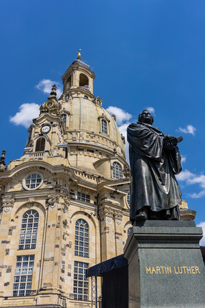 DRESDEN, GERMANY - May 21, 2018: Martin Luther memorial statue near the restored Frauenkirche. Martin Luther a seminal figure in the Protestant Reformation.