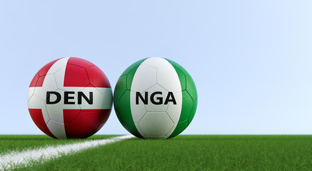 Denmark vs. Nigeria Soccer Match - Soccer balls in Denmark and Nigeria's national colors on a soccer field. Copy space on the right side - 3D rendering