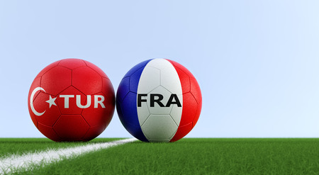 Turkey vs. France Soccer Match - Soccer balls in Turkey and France national colors on a soccer field. Copy space on the right side - 3D Rendering Foto de archivo - 109467734