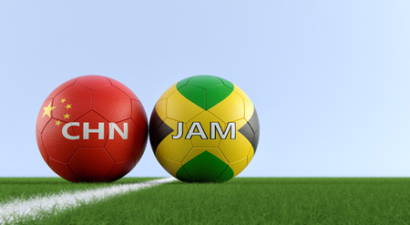 Jamaica vs.China Soccer Match - Soccer balls in Jamaicas and Chinas national colors on a soccer field. Copy space on the right side - 3D Rendering