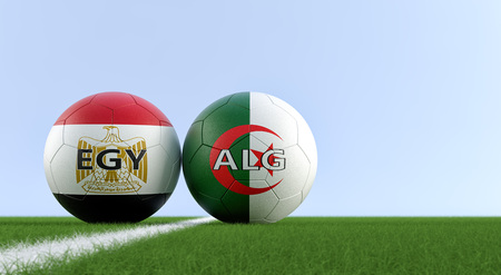 Egypt vs. Algeria Soccer Match - Soccer balls in Algeria and Egypt national colors on a soccer field. Copy space on the right side - 3D Rendering