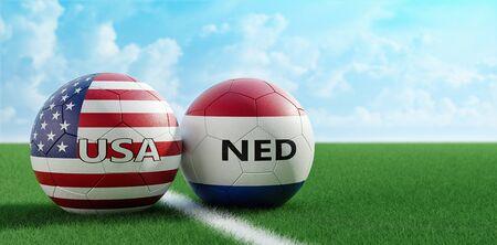 USA vs. Netherlands Soccer Match - Soccer balls in USA and Netherlands national colors on a soccer field. Copy space on the right side - 3D Rendering Reklamní fotografie