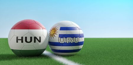 Hungary vs. Uruguay Soccer Match - Soccer balls in Uruguay and Hungary national colors on a soccer field. Copy space on the right side - 3D Rendering