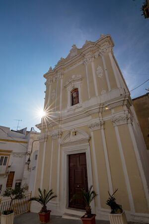Beautiful facade of church with Sun diffraction in Laterza. Puglia. Southern Italy. Scenery summer clear blue-sky day