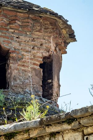 Architectural detail, partial ruined tower, street view of Aslan Pasha Mosque in the fortress of Ioannina in Greece, sunny spring day