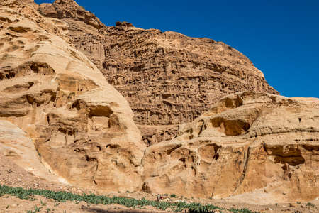 Cliff formations. I have enjoyed the amazing views from the scenery Monastery Route, beautiful sunny day at Petra complex and tourist attraction, Hashemite Kingdom of Jordan