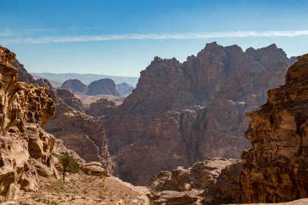 Desert view with cliff formations. Amazing scenes at Monastery Route, beautiful sunny hazy and dreamy day at Petra complex and tourist attraction, Hashemite Kingdom of Jordan 版權商用圖片