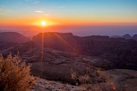 Beautiful scenery landscape. Mountain view at sunset over the desert mountains at Wadi Musa, Hashemite Kingdom of Jordan. The edge between the golden and blue hours
