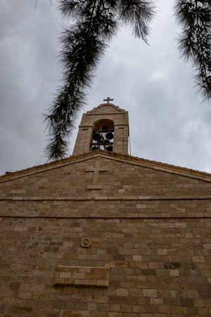 Front wall with bell tower, Greek orthodox basilica of Saint George, Madaba city in Middle East country Kingdom of Jordan.