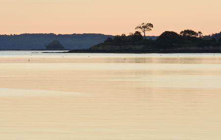 reflecting: sunrise at coast of freeport in maine