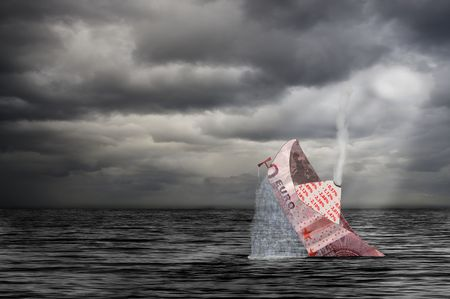 sinks: ten euro bank note folded to a ship sinks at storm in the sea