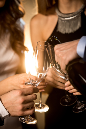 Close-up partial view of happy friends drinking champagne Stock Photo