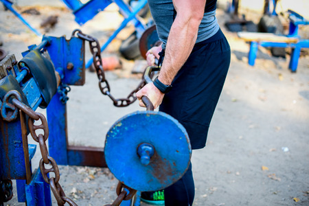 Cropped shot of strong man with barbell during workout Stock Photo