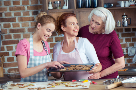 Happy family of three generations making Christmas cookies together Stock Photo