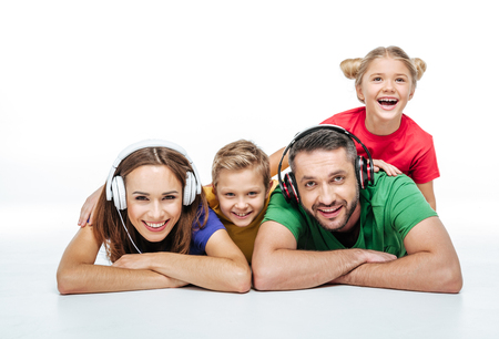 Parents in headphones with kids isolated on white Stock Photo