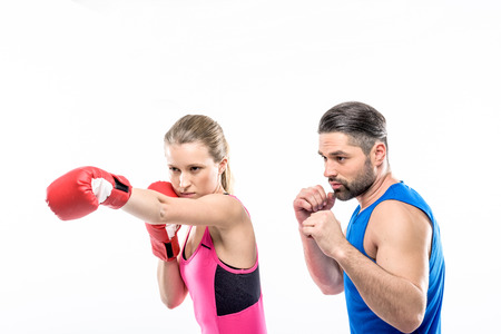 Girl practicing boxing with her personal trainer on white Stock fotó