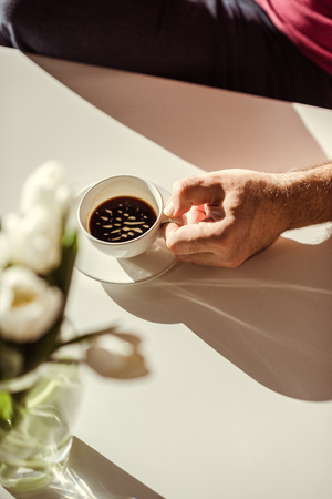 Man holding coffee cup Stock Photo