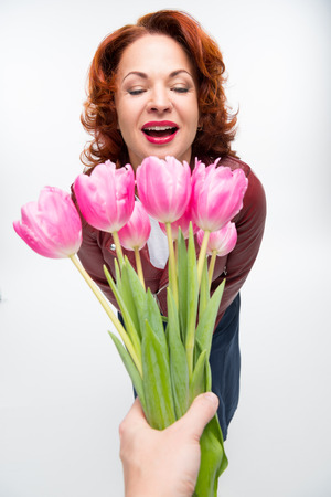 forced perspective: Man presenting flowers to woman