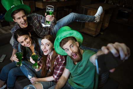 friends with beer making selfie on St.Patricks day