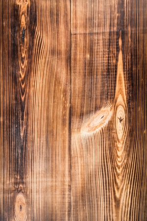 frame of brown textured wooden background