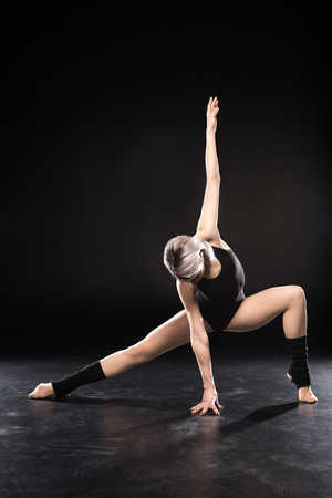 Athletic young woman contemporary dancer posing Stock Photo