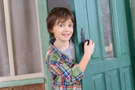 boyhood: boy standing in door and looking to camera