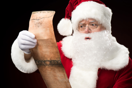 christmastime: Santa Claus reading wishlist Stock Photo