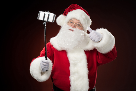 Santa Claus taking selfie