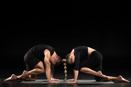 pada: Couple performing acroyoga Stock Photo