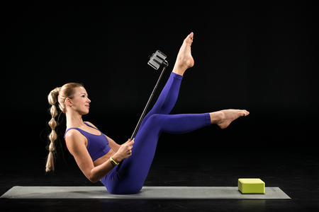 kundalini: Yoga woman taking selfie