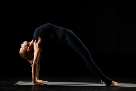 Woman standing in yoga position Stock Photo