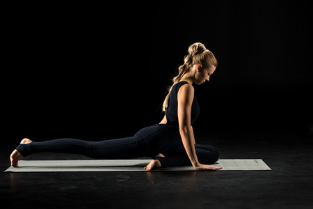 Woman sitting in yoga position Banco de Imagens