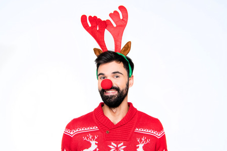 Smiling man in antlers and red nose Stock Photo