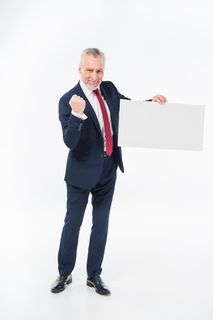 Businessman holding blank card Stock Photo