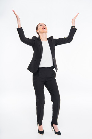triumphing: Cheerful businesswoman triumphing Stock Photo