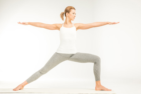 Woman standing in yoga position Reklamní fotografie - 73905946