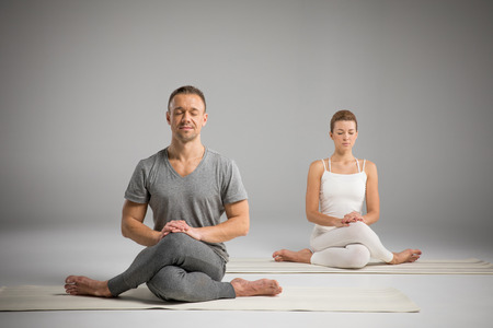 shoelace: Man and woman practicing yoga Stock Photo