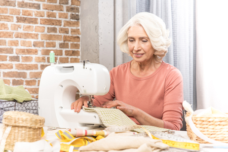 Woman with sewing machine Stock Photo