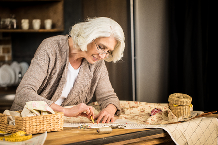 Seamstress working with fabric Stock Photo