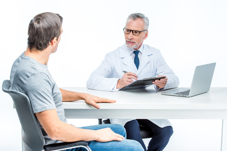 Mature doctor with patient Stock Photo