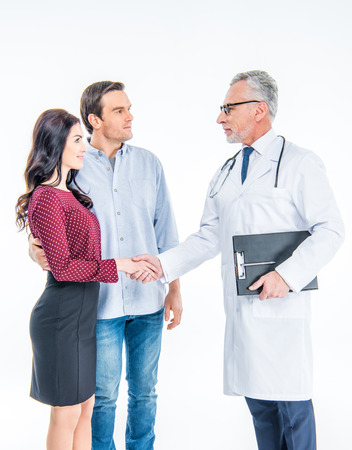 Young couple and doctor Stock Photo