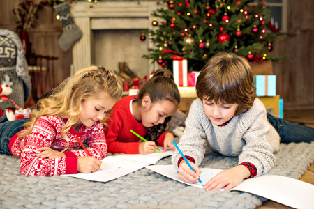 christmastime: Happy kids drawing picture Stock Photo