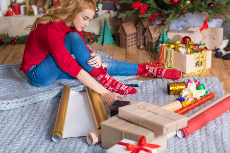 Girl wrapping gift boxes Stock Photo