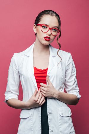 a lady doctor: portrait of confident professional doctor in white coat and glasses