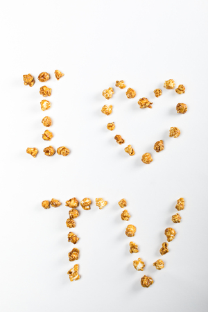 top view of I love TV made of popcorn