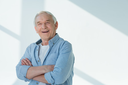portrait of smiling senior man in casual shirt