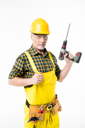 laboring: Workman holding electric drill Stock Photo