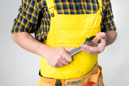 laboring: Workman with tool belt Stock Photo