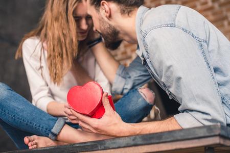 Man receives present from girlfriend