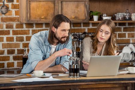 homeoffice: Couple using laptop Stock Photo